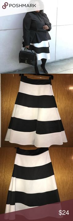 Black and white skater skirt Black and white horizontal skater skirt. Skirt is a midi length Fashion to Figure Skirts Circle & Skater