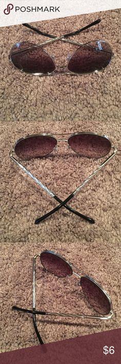 Gold twisted sunglasses. Super cute gold twisted sunglasses. Black fades lenses. Good condition Accessories Sunglasses