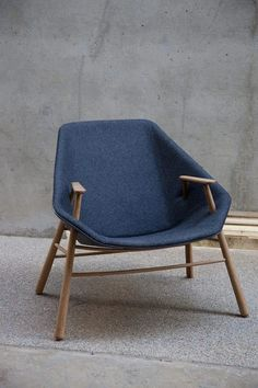 really great the way the hard wood frame and arms break through the soft upholstered shell. unexpected. would like to sit in it.
