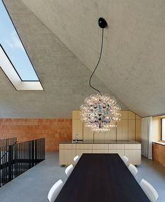 Exposed Concrete Walls at Residential and Dental Practice by Architekten Rüf Stasi Partner unusual complex pitched roof