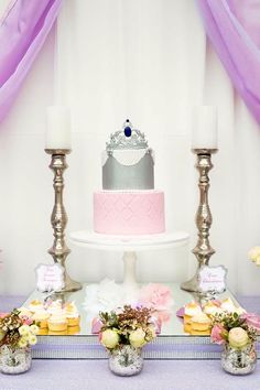 Gorgeous candles flanking a princess cake from an Elegant Purple Princess Birthday Party at Kara's Party Ideas.