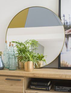 Mirror Eden from COCO maison with antique brass details.