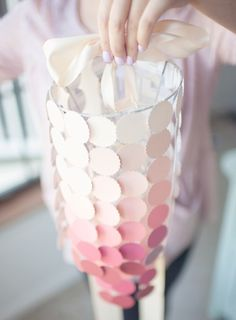 DIY Baby Mobile from Paint Chips - Will be doing this in White, Grey, Black ------------------ What a great idea!!!!! Thankfully paint chips are free! Lol
