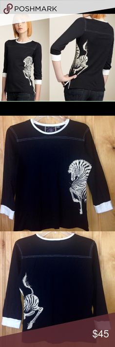 """LAMB Blk Wht Zebra 3/4-Slv Slim Fit TOP $75 EUC L Gwen Stefani LAMB Black White Zebra 3/4-Slv Slim Fit TOP $75 EUC L •DETAILS:  *Fall 2007 Collection. Retail Price: $75.00 *Lightweight, 3/4-Sleeve Slim-Fit Top.  *Contrast Banding at Crew Neck & Cuffs w/ Top Stitching at Yoke.  *Beautiful Zebra Artwork on Front & Back, as well as One Side!   *Only worn 3-4 times! In GREAT Shape! •MEASUREMENTS: Bust is 38"""" - 40""""; Length- 22"""" •MATERIAL: 100% Cotton •CARE: Machine Wash Cold **SMOKE-FREE…"""