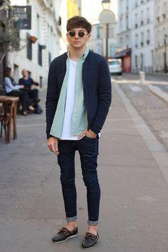Navy bomber jacket, light green shirt, white tee, navy jeans, navy shoes