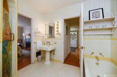 Original 1933 white and yellow art deco bathroom. 3045 21st Ave, San Francisco, CA 94132.