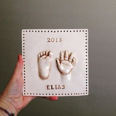 As a mother, I adore my cherished keepsakes of my children. I love to be able to give my children their sweet handprints to share with their own families and pass on the tradition. A personalized wall decor handprint keepsake of your baby to last a life time. Pop out, 3-D style allows you to see and feel the raised hand and foot print. This first photo is glazed in Miami Pink background and feet are left white. This gives a real defined pop out look or I can glaze whole plaque solid color…