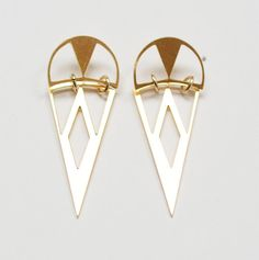 These stunning earrings are versatile a great for everyday wear.  Featuring a beautiful tribal pattern.  The 14k gold plated pendants were