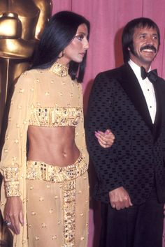 Take a walk down red carpets through the years with Cher in this round-up of her most iconic Oscar looks...