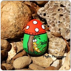Mushroom and Worm - Painted rock by Phyllis Plassmeyer