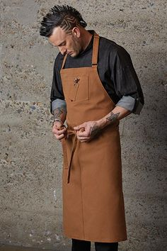 Nutmeg Rockford Chefs Bib Apron Style: Bib Adjustable Neck: Yes Colors: Nutmeg Material: Cotton Pattern: Solid Dimensions: x Pockets: 2 Brand: Chef Works Care: Machine-washable Origin: Imported Restaurant Aprons, Restaurant Uniforms, Cool Aprons, Aprons For Men, Cafe Apron, Jean Apron, Custom Aprons, Apron Designs, Bib Apron