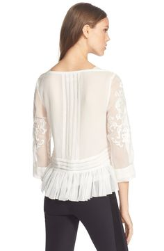 Free shipping and returns on Rebecca Taylor Embroidered Paisley Peplum Top at Nordstrom.com. An embroidered paisley design scrolls over the ethereal silk of a charming top finished with a pleated peplumhem.