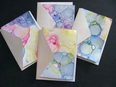 Paint, dawn, and a little water in cups. Blow into each through straw to make bubbles. Place paper on top to print. Fun!