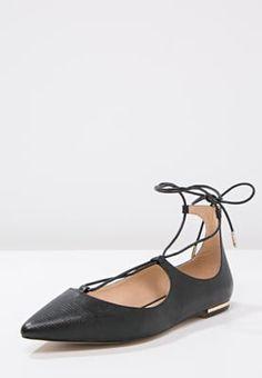 Ballerina's met bandjes KIOMI Ballerina's met enkelbandje - black Zwart: € 59,95…