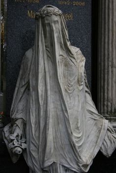 Statue at Zentralfriedhof Cemetery, Vienna Austria. Beethoven, Brahms, Schubert, and Strauss are all buried there.