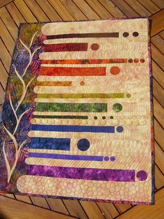 batik rainbow quilt.  Interesting way to show off a lot of quilting stitches.