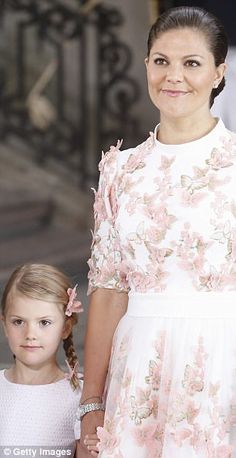 Mummy's girl: Princess Estelle wore butterfly hair pins to match her mother's pretty pink dress