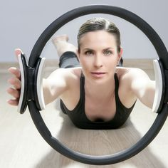 The magic bullet for a toned butt may just be the magic circle! This Pilates tool can totally sculpt your backside.