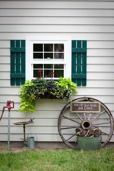 wagon wheel, shutters, window box- maybe the shutter but....