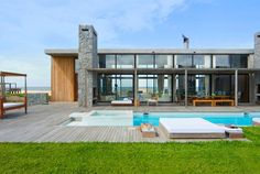 Coolest house ever - pool & grass out one side, ocean on the other. Awesome outdoor fireplace with heaps of decking and outdoor seating.