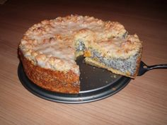 Poppy Seed Cake with Streusel  _    The German Poppy seed cake has  a delicious filling made out of vanilla pudding and poppy seeds, and on top there is a layer of Streusel