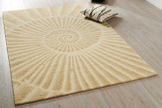Ein dezentes Beige drängt sich nicht auf, das eingearbeitete Schneckenmuster kann dennoch einen Akzent setzen. #homestory #home #carpet #trends #colour #interior