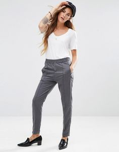Buy it now. Maison Chic Jogger Pants - Grey. Trousers by Maison Scotch, Wool-mix woven fabric, High-rise waist, Stretch waistband, Faux fly, Functional pockets, Tapered leg, Slim fit - cut close to the body, Dry clean, 50% Polyester, 48% Wool, 2% Elastane, Our model wears a UK 8/EU 36/US 4 and is 162cm/5'3.5 tall. ABOUT MAISON SCOTCH From the house of Amsterdam-based label Scotch & Soda, Maison Scotch channel a rock chic aesthetic and Parisian je ne sais quoi, bringing forth beautifully…