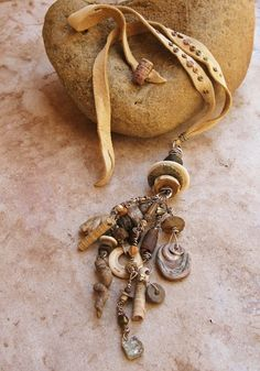 Primitive Talisman Pendant with Sterling Silver, Fossils, Rustic Clay, Ancient Glass, Shell, Handmade Metal Beads, and Deerhide