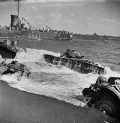Equipment partially submerged at Iwo Jima, 1945 LIFE Behind the Picture: Marines Blasting a Cave, Iwo Jima, 1945   LIFE.com
