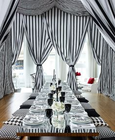 black and white table, cushioned seat pillows and curtains, very chic! InGoodTaste:FrancescoLagnese
