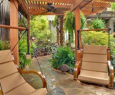 terrassengestaltung gartensessel kieselsteine und steinpflaster