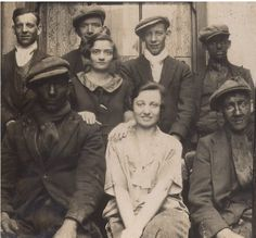 Welsh mining family 1930s, the lady seated centre would become their sister in law and the wife of the photographer. Cwmparc, Rhondda, S. Wales.