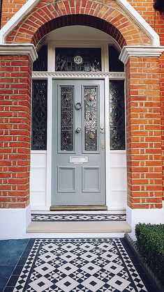 Front Door Brick House Victorian Black And White Mosaic Tile Path Battersea York Stone Rope Edge Buxus London Front Garden Front Door Stepshouse Front Door Paint Colors Red Brick House Navy Front Door Front Door Steps, Front Door Porch, Front Door Entrance, House Front Door, Glass Front Door, House Entrance, House Doors, Front Path, Front Entry