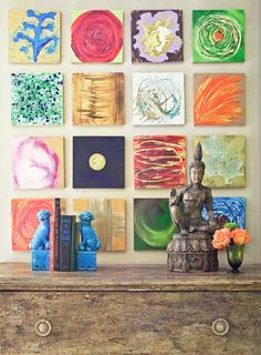 Small, unique and colorful canvases grouped together. From the Big, Easy Style book on New Orleans interiors by author Bryan Batt.
