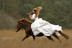 Playing the violin...while riding a galloping horse. That's impressive. By Katarzyna Okrzesik
