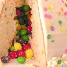 Skittles cake  http://easybaked.net/2012/09/16/candy-surprise-cake/