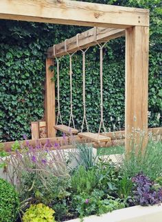 We designed this Swing Garden to be functional and low maintenance with a playful focus. Features include swings, pergola and outdoor kitchen. #LandscapingandOutdoorSpaces