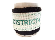 Hunger Games crocheted coffee cozy. District 11, where i live