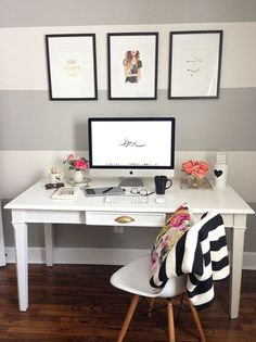 Home decorating ideas - small home office with grey and white striped wall, wood desk, Eames chair and graphic artwork above desk.
