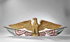 Large Gilt and Polychrome Decorated Carved Spreadwing Eagle Architectural Plaque. | Auction 2922M | Lot 727 | Estimate $4,000-6,000
