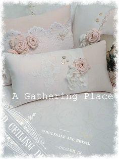 Soft pink vintage Damask Pillow showcasing a sweet Tattered Rose....