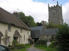 St. Clement church, the lychgate and thatched cottages
