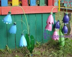 plastic bottle upcycling flowers.  The pin links to a site in Russian, but has some neat pictures/ideas.
