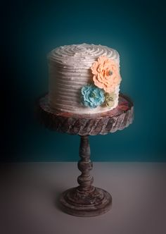 Shabby Chic - Birhtday cake for a 21 year old. Used the ruffled buttercream technique with fondant fantasy flowers.