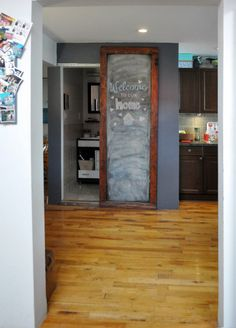 Amy & Meghan's Charming Nest in Williamsburg | smart way to dress up (and disguise) the bathroom door that faces the entrance