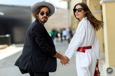Giotto Calendoli & Patricia Manfield on a street style photo taken during Pitti Uomo in Florence.