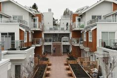 Cohousing units face on to a central courtyard to encourage interaction between residents. Photo Dan Toulgoet