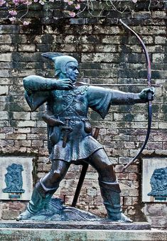 Nottingham castle's famous Robin Hood statue, until now. It is the work of James Woodford back in 1952.