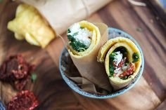 The wrap is made of egg whites and whole eggs. Filled with wilted baby spinach, hunks of tangy feta, fragrant basil and sun-dried tomato bits.