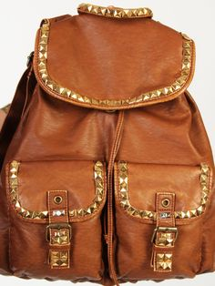 DIY: studded backpack = could possibly do this to my black bag, it's so beat up.